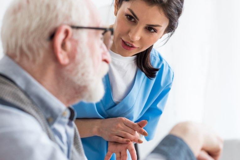 nurse talking to elderly man