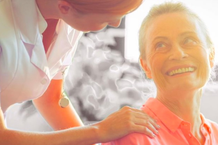 carer looking at mature woman